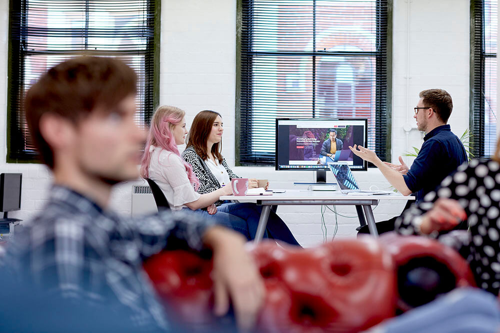 Strafe Team members collaborate at their digital design agency offices